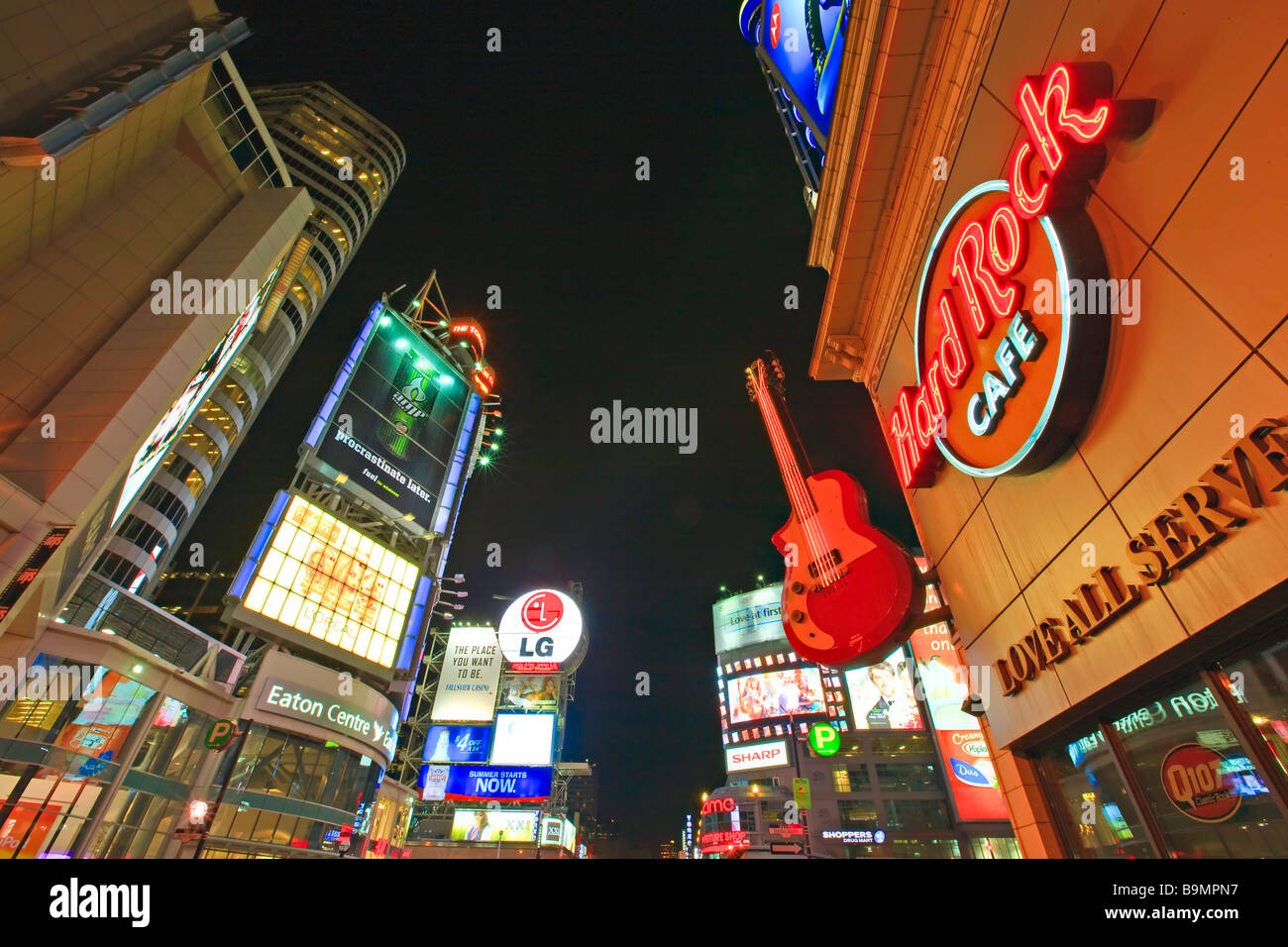 Eaton Centre, Hard Rock Cafe and Yonge Dundas Square seen along Yonge Street in downtown Toronto at night Ontario - Stock Image