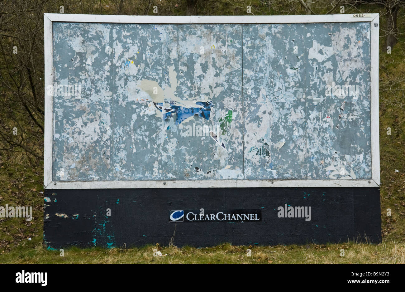 Empty and tattered ClearChannel advertising billboard on waste ground in Ebbw Vales South Wales UK - Stock Image