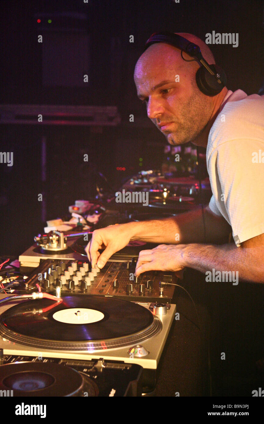 Dom Search (aka Dominic Betmead) of 'The Nextmen' DJing at a night club - Stock Image