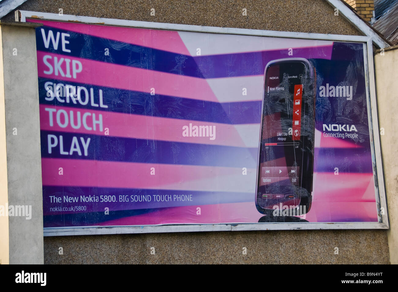 Advertising billboard for Nokia mobile phone on wall of pub building at Crumlin in South Wales Valleys UK - Stock Image
