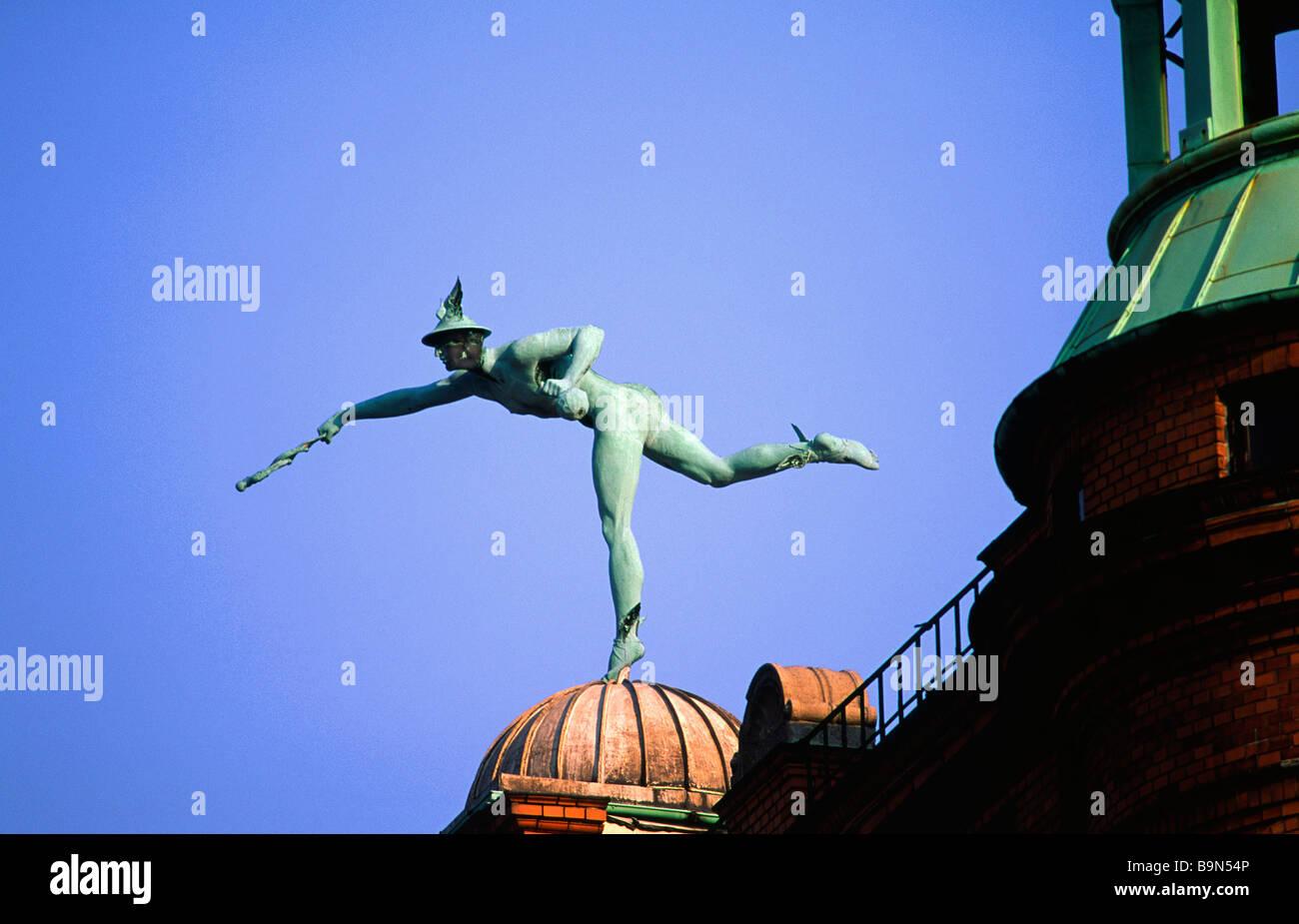 Denmark, Copenhagen, Nyhavn District (the New Port), winged messenger on a roof Stock Photo
