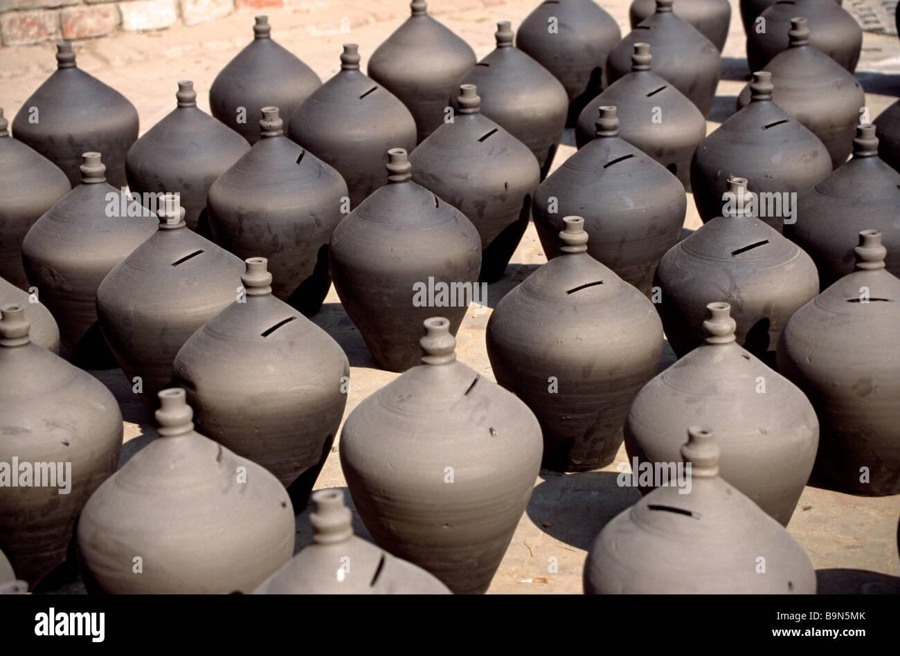 Nepal, Kathmandu Valley, Bhaktapur, earthenware banks drying in the sun - Stock Image
