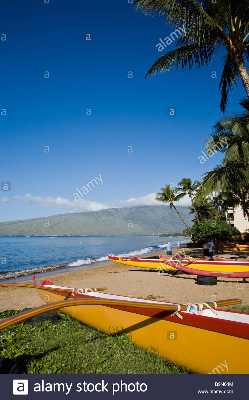 Outrigger canoe on Sugar Beach on the island of Maui in the state of Hawaii USA - Stock Image