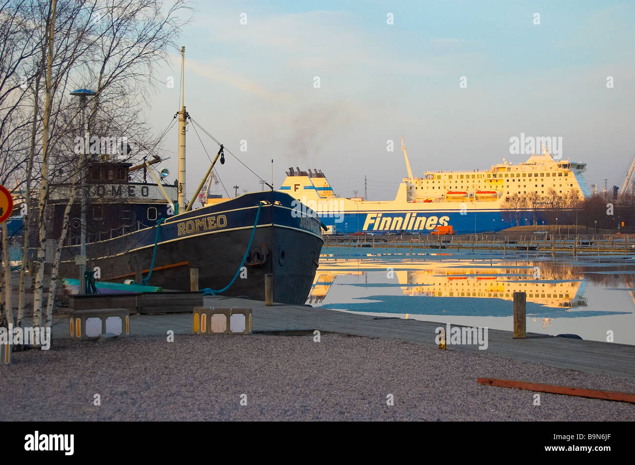 A view to a boat and ferry at Helsinki bay, Finland. - Stock Image