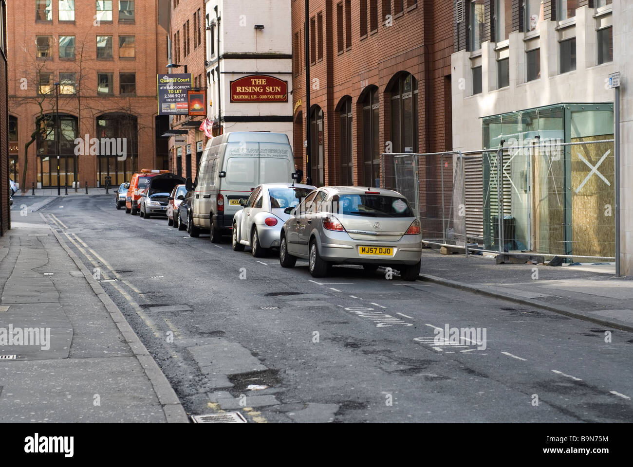 Cars parked in Manchester city centre UK Stock Photo