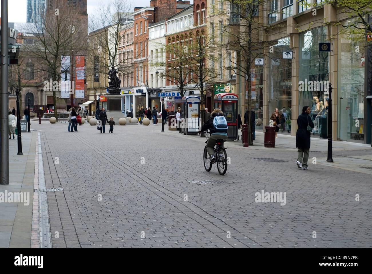 People walking in St.Ann Square Manchester city centre UK - Stock Image