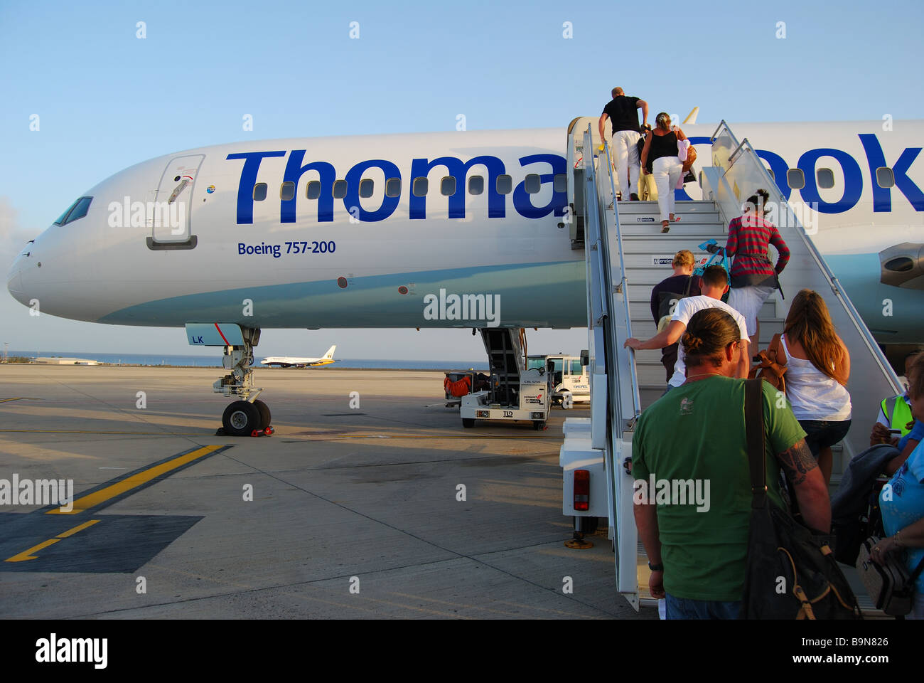 Passengers boarding Thomas Cook Boeing 757-200, Arrecife Airport, Arrecife, Lanzarote, Canary Islands, Spain - Stock Image