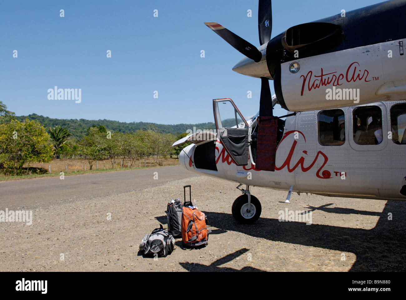 Small Nature Air propeller plane on runway, Drake Bay, Costa Rica. - Stock Image