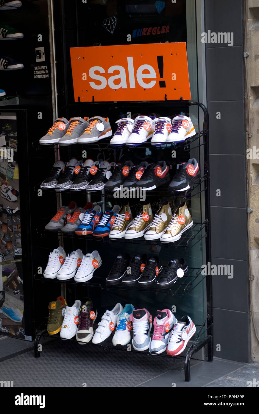 Shoes on sale stand outside shop in Manchester city centre UK - Stock Image