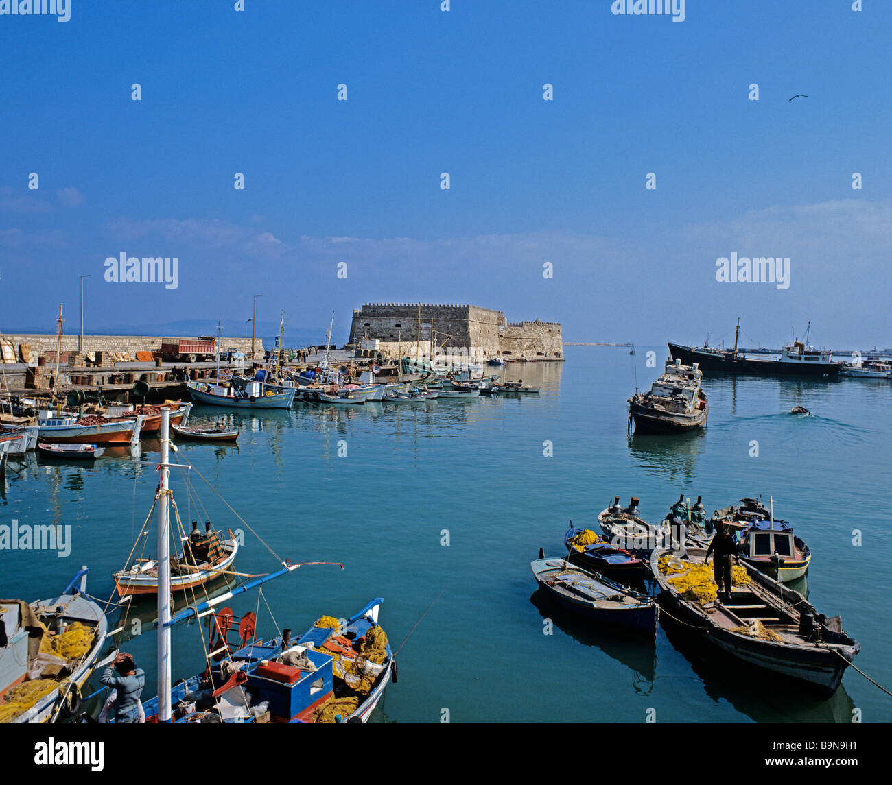 Fishing boats in the old fortified Venetian Harbour of Iraklion on the north coast of Crete - Stock Image