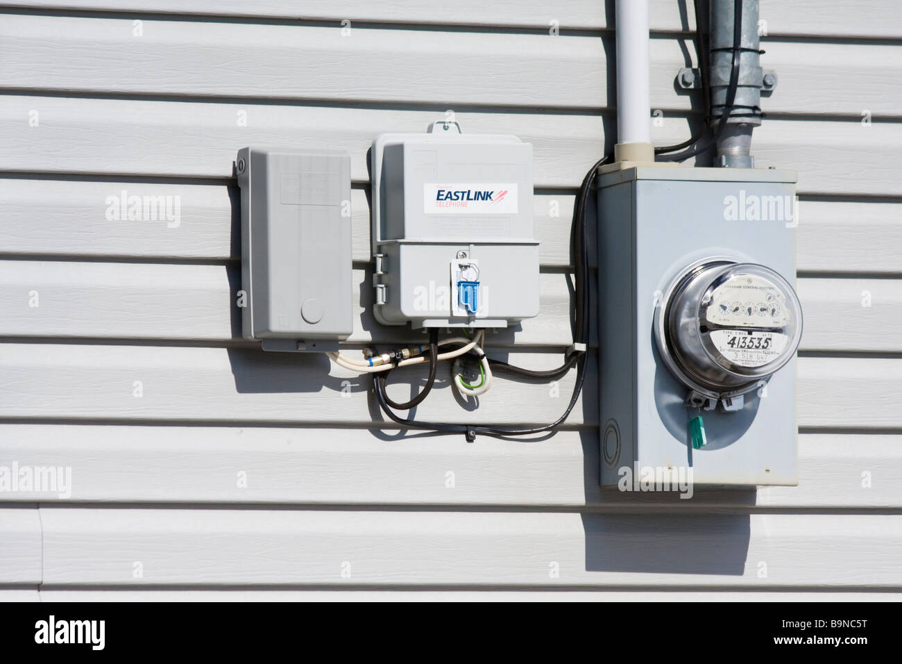Electricity meter and cable box in Halifax, Nova Scotia, Canada - Stock Image