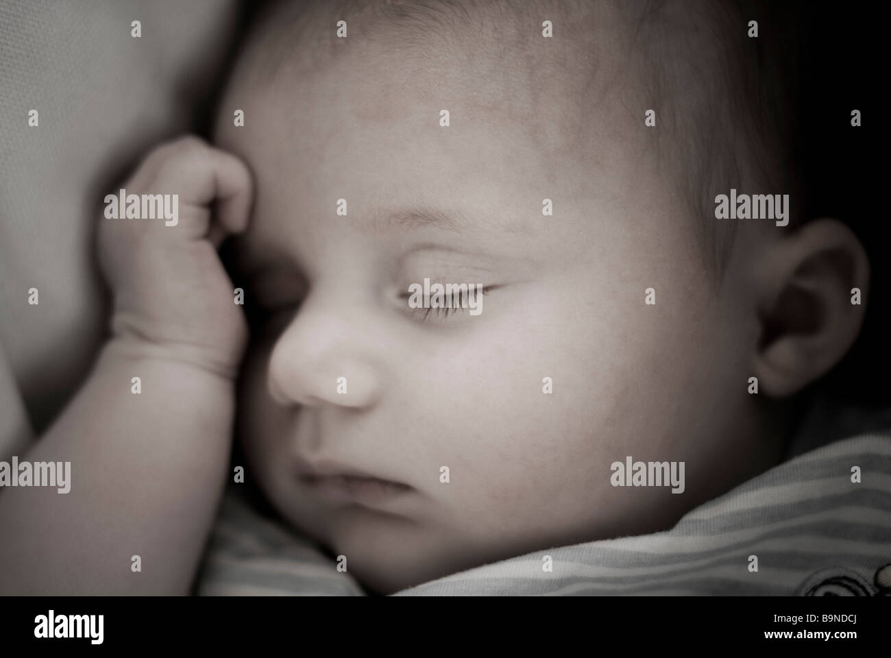 Close-up of baby sleeping - Stock Image