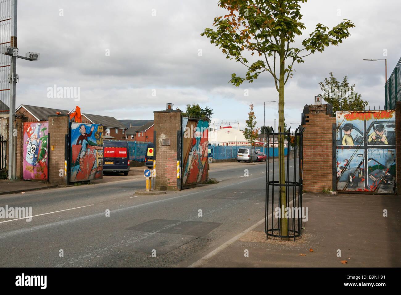 Gates in a peace line, Lanark Way, West Belfast. - Stock Image