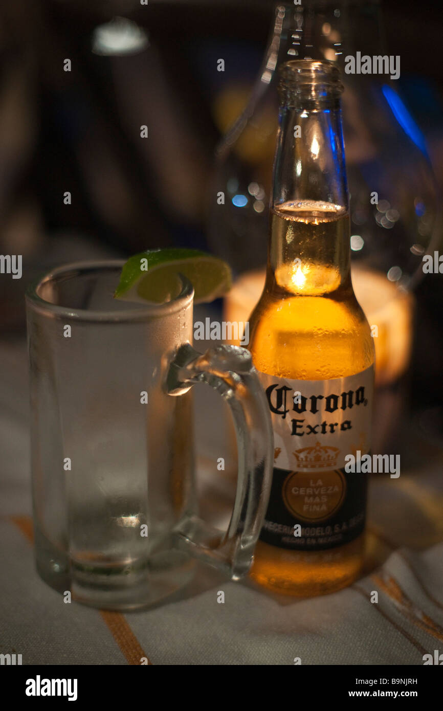Mexico Yucatan 2009 Corona Extra beer by candelight outdoors at night - Stock Image
