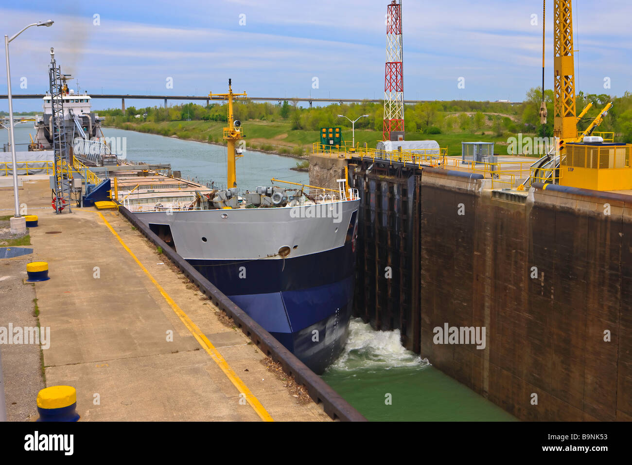 Large bulk carrier ship entering Lock 3 of the Welland Canals System at the St Catharines Museum,Welland Canals - Stock Image