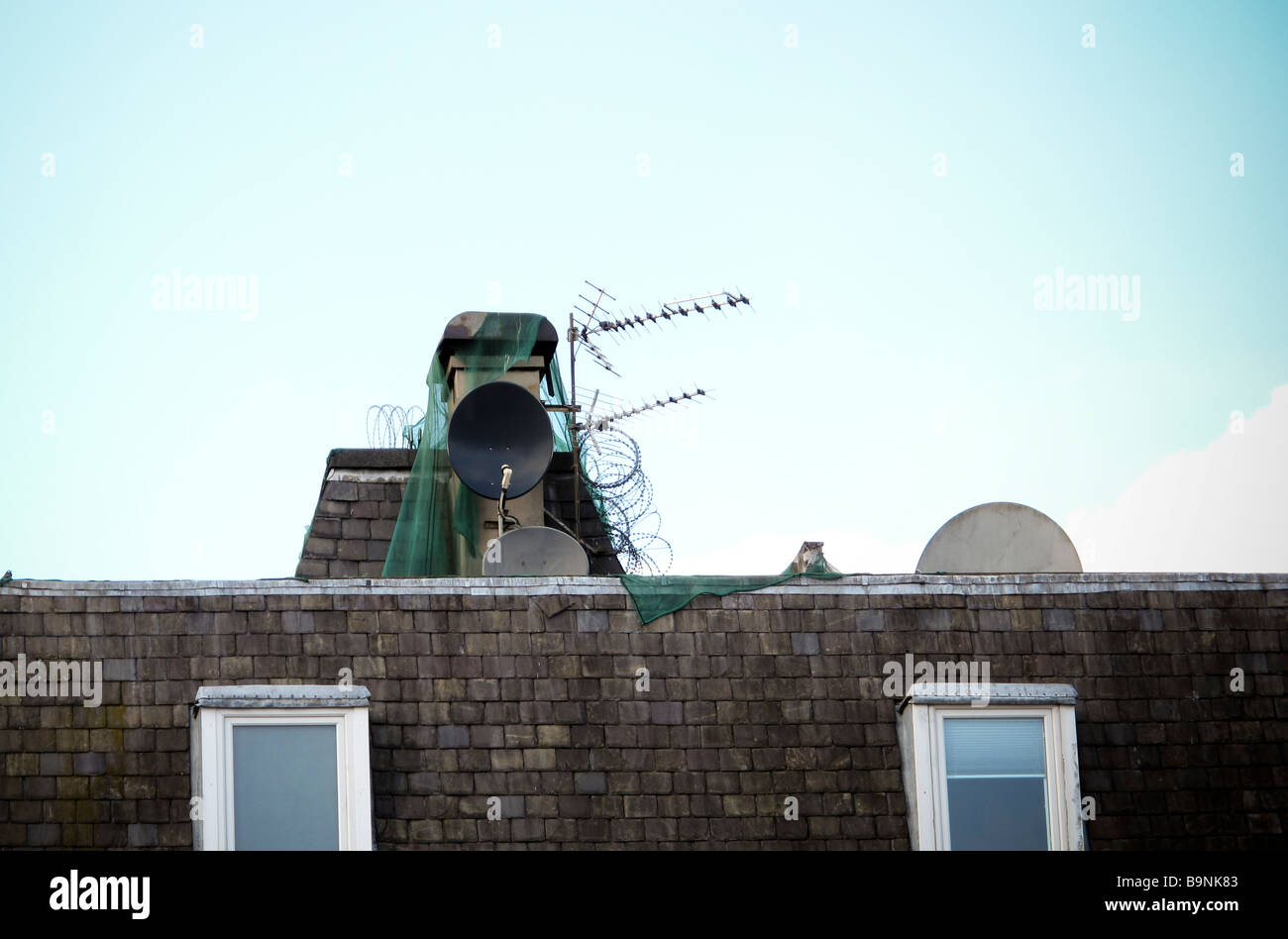 Satellite dishes and aerials on roof Stock Photo