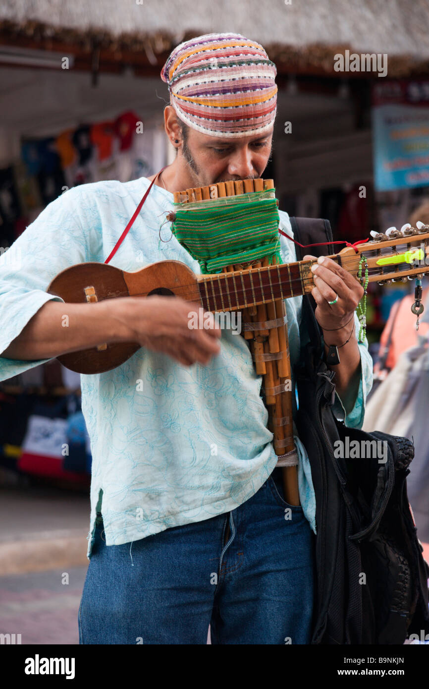 Mexico Yucatan - Playa del Carmen, a Peruvian trovadore busker with charango stringed instrument and pan pipes - Stock Image