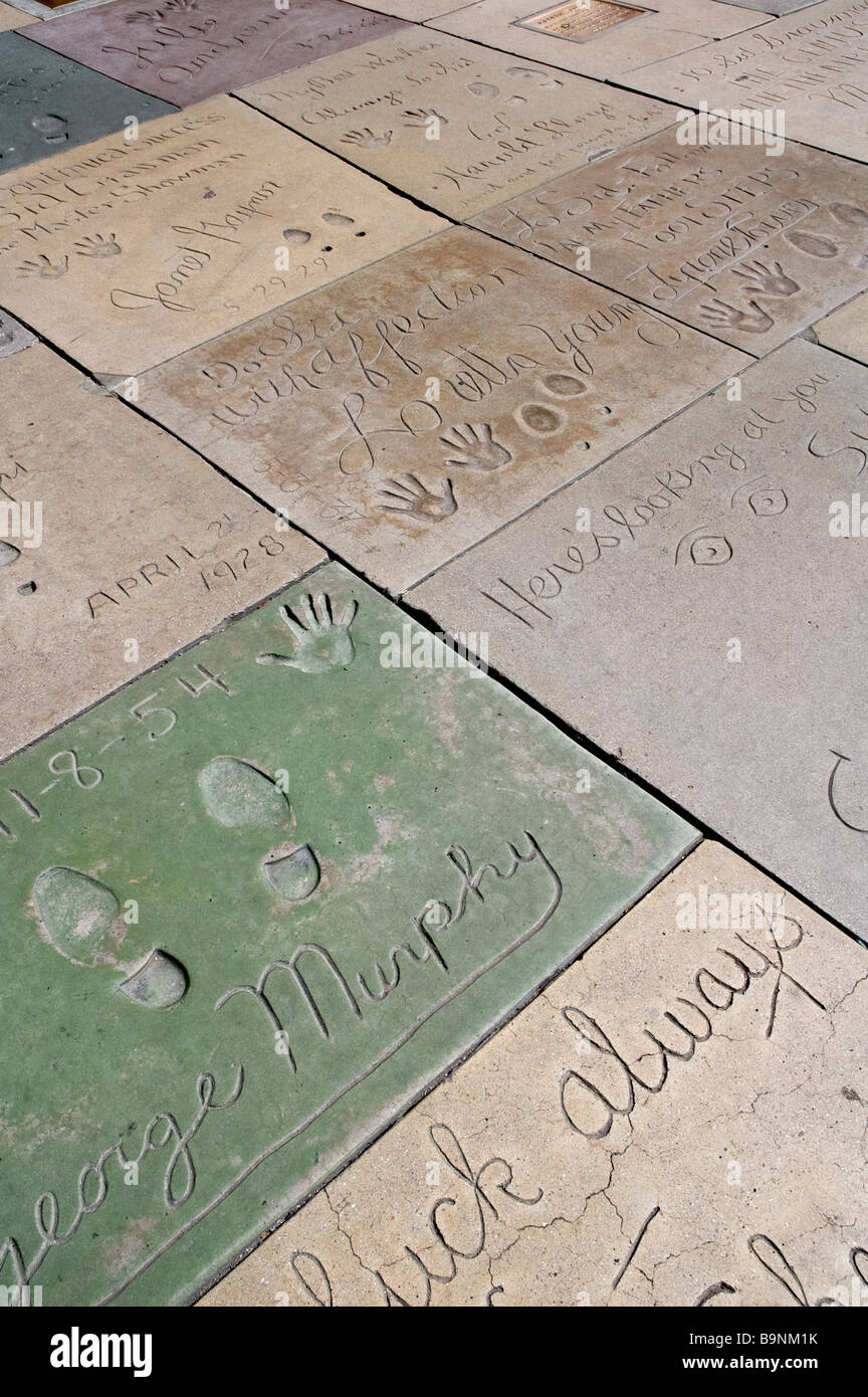Foot prints and hand prints of various stars and celebrities from the 1920's to present day; Grauman's Chinese - Stock Image