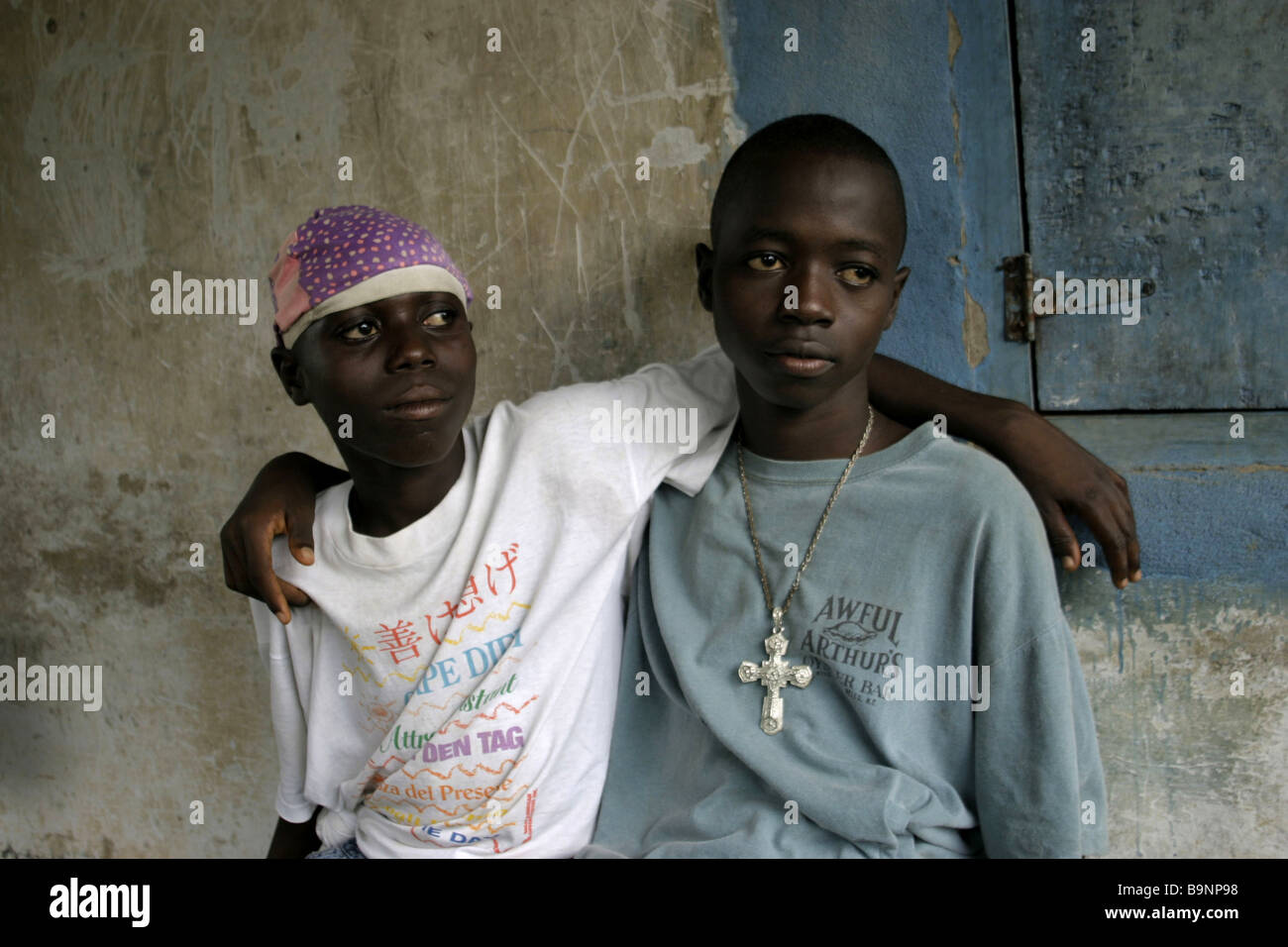 Two ex-child soldiers at a rehabilitation centre in Liberia. These teenage boys had fought for rebel forces during - Stock Image