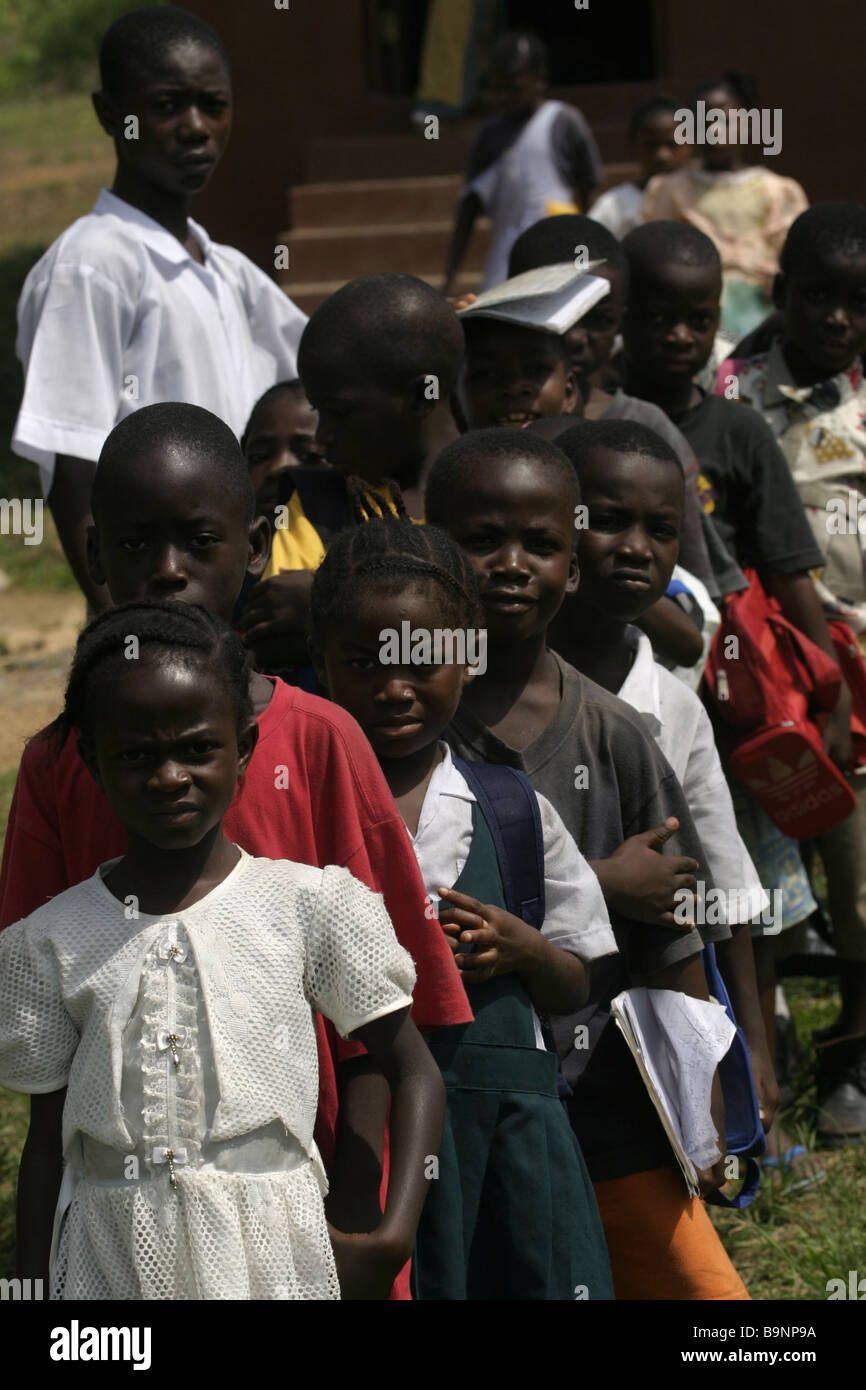 A group of young schoolchildren queue for a lesson at a school in the north of Liberia - Stock Image
