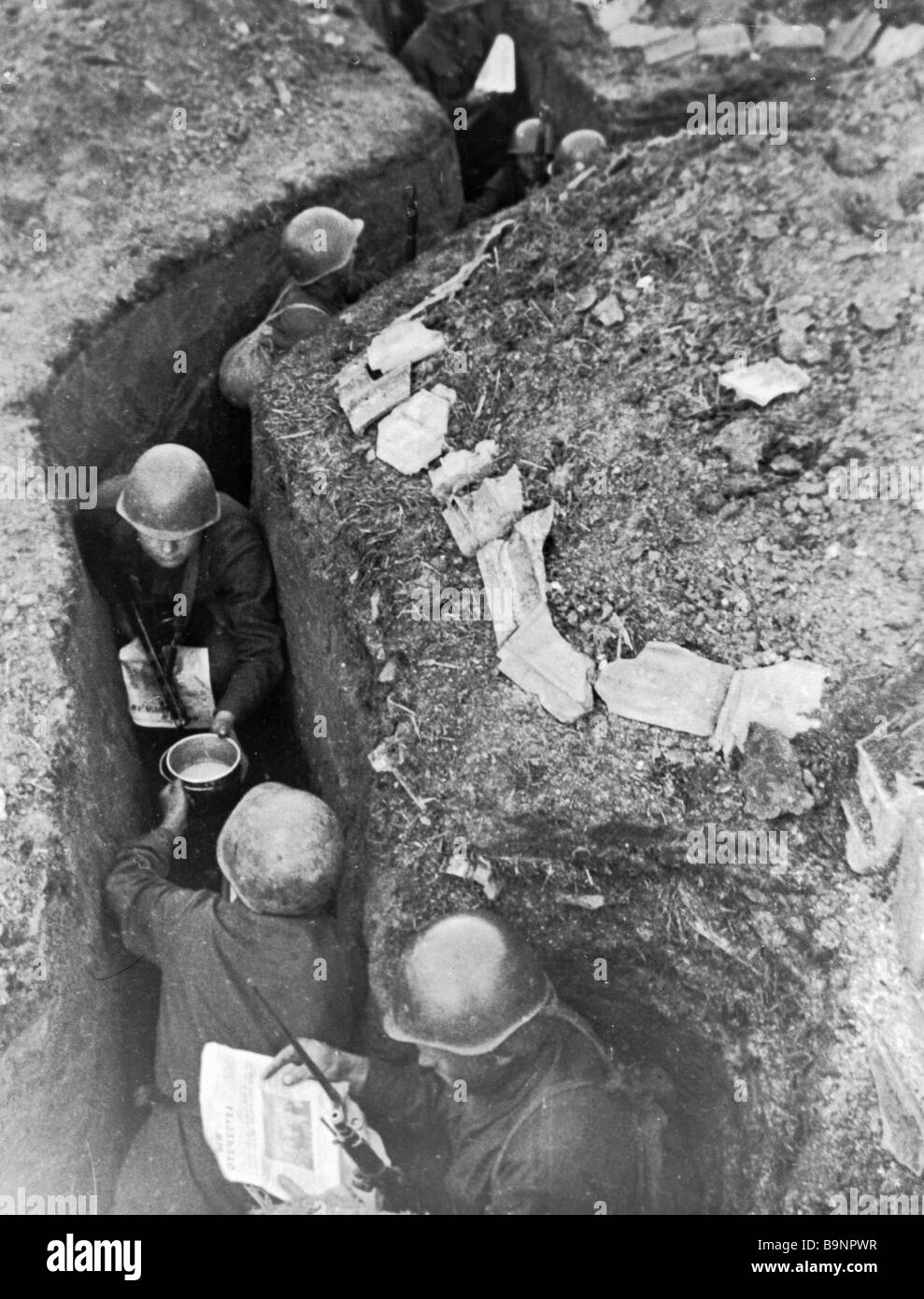 Soviet soldiers having rest in trenches between battles - Stock Image