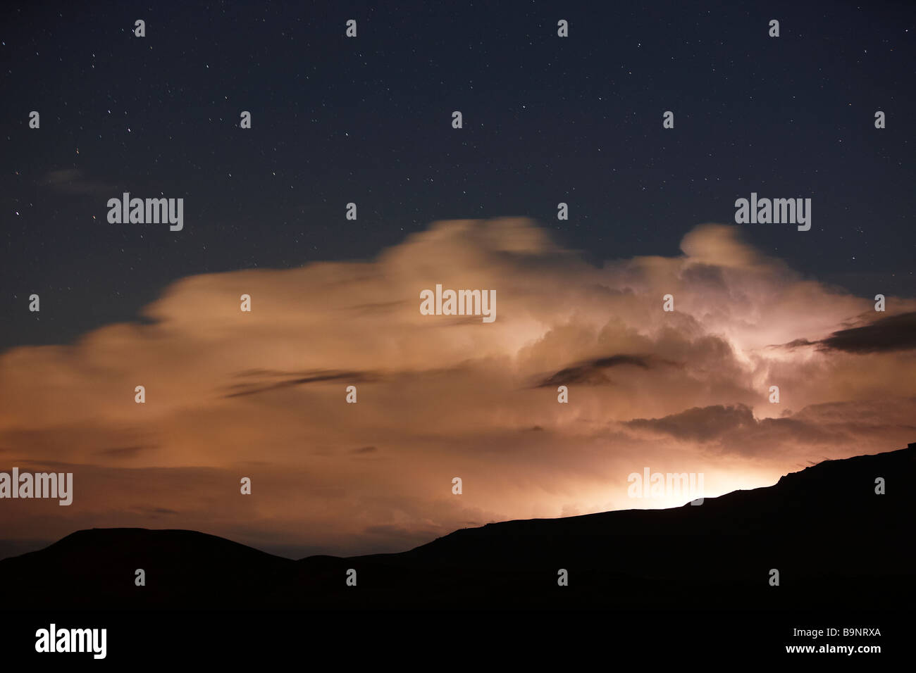 thunderstorms, lightening and stars over the Drakensberg Mountains, KwaZulu Natal, South Africa - Stock Image