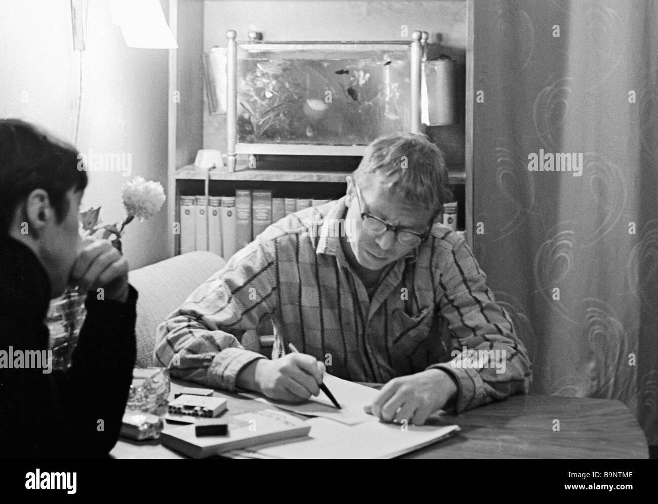 Yury Belov right creates special concert programs for circus performer Leonid Yengibarov left - Stock Image