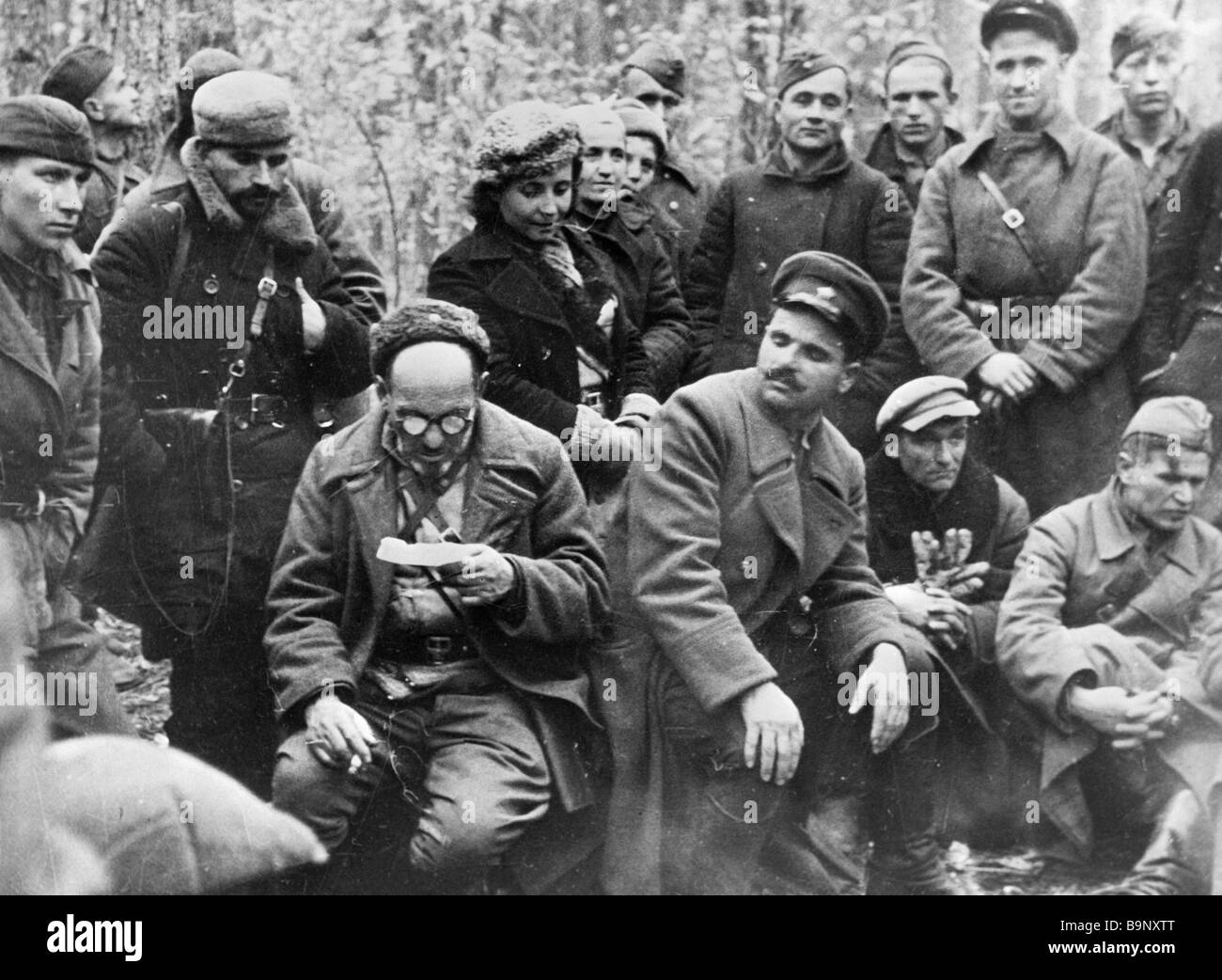 Commander of the Sumy guerrilla department S A Kovpak left sitting reading out a cipher message Commissar S V Rudnev Stock Photo