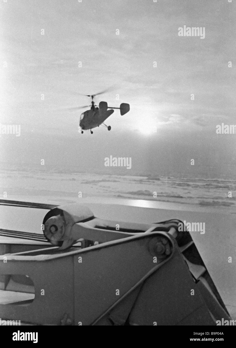 Helicopter landing on Lenin nuclear powered icebreaker deck after ice reconnaissance - Stock Image