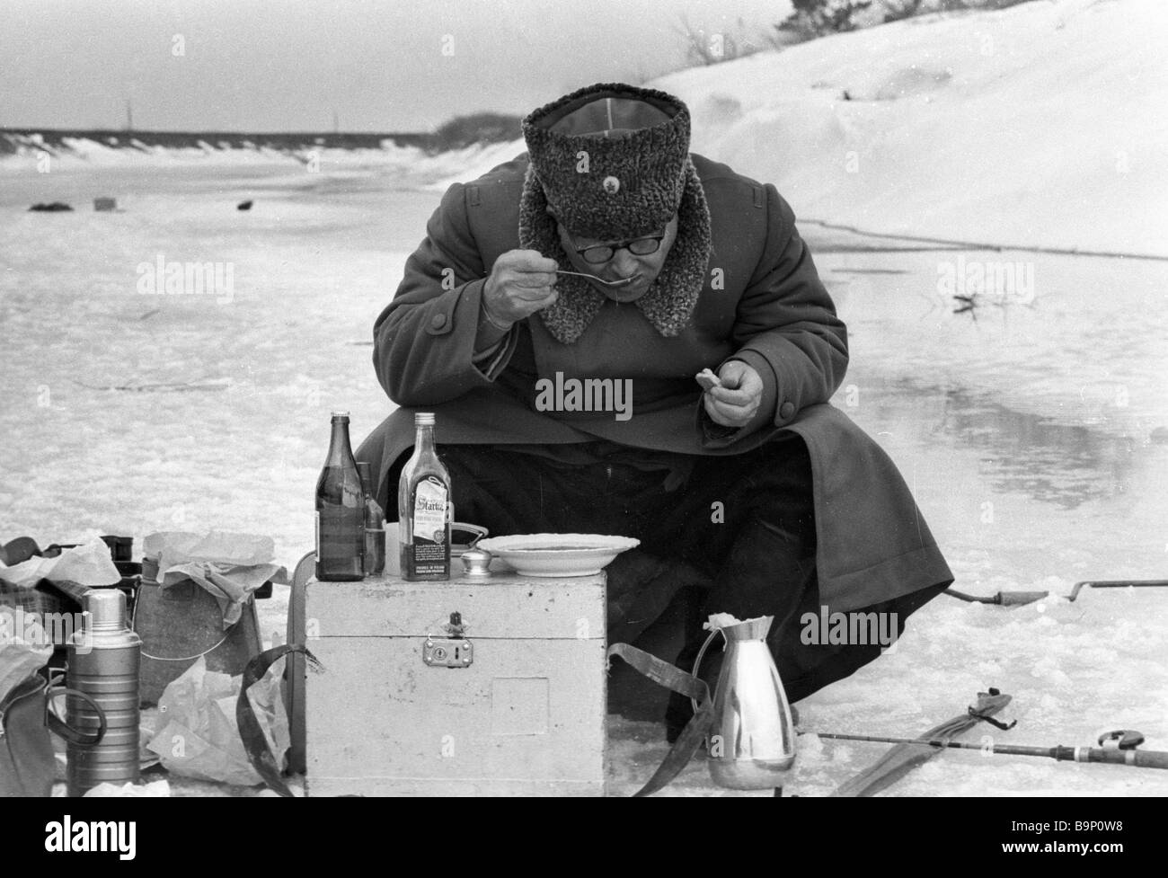 Marshal Ivan Konev has a meal on a winter fishing outing - Stock Image