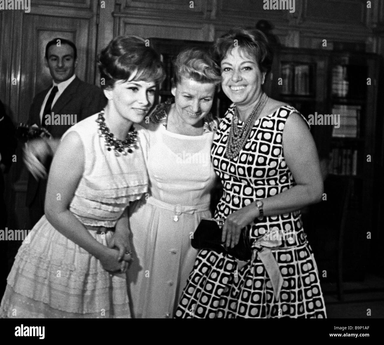 Italian actresses Gina Lollobrigida left and Marisa Merlini right attend reception organized by Soviet Culture Minister - Stock Image