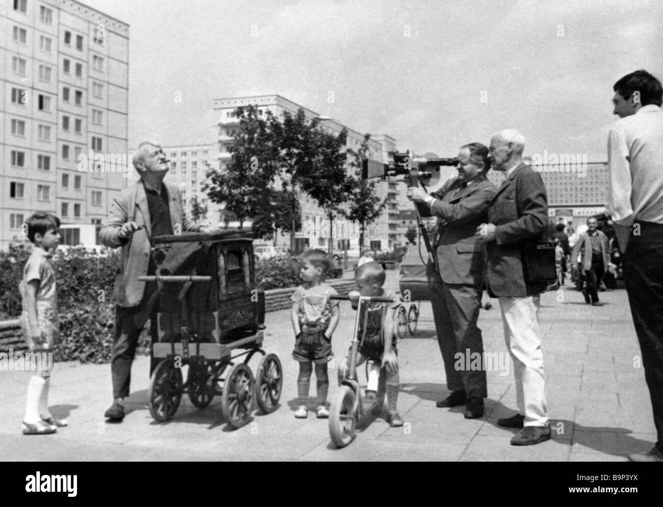 Soviet documentary film maker Roman Karmen second right films scene on city street for documentary Comrade Berlin - Stock Image