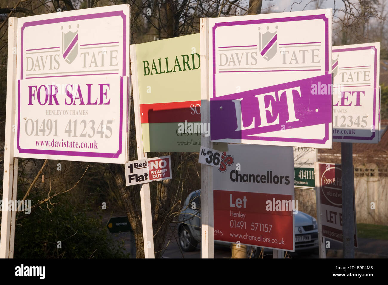 Estate Agent signs, 'Sold', 'To Let' - Stock Image