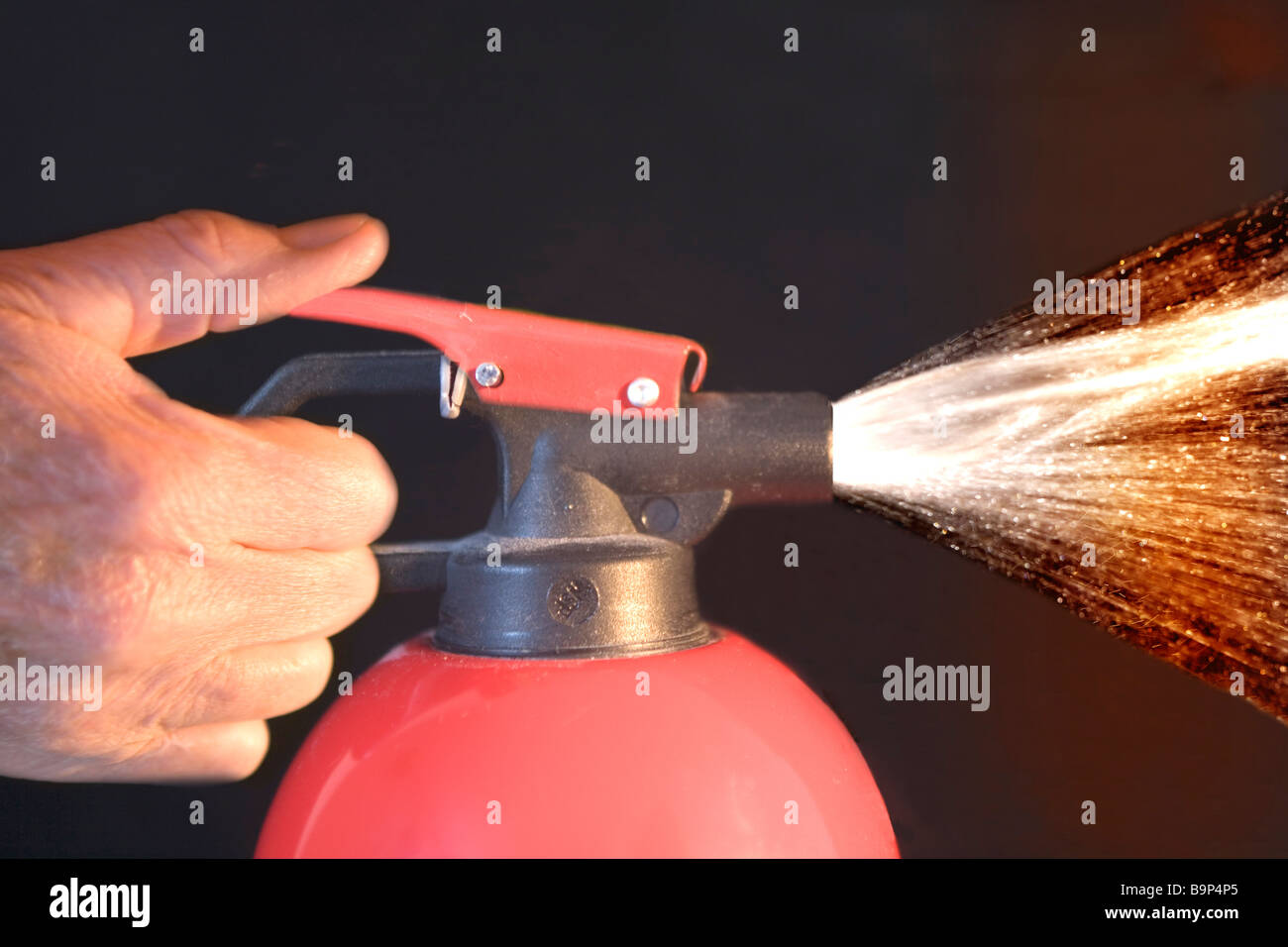 Fire extinguisher in use - Stock Image