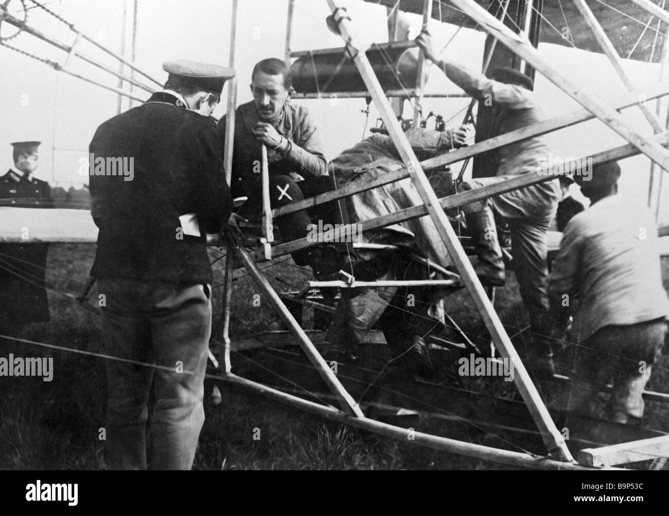 Nikolai Popov one of Russia s first airmen 3rd left prepares for a flight - Stock Image