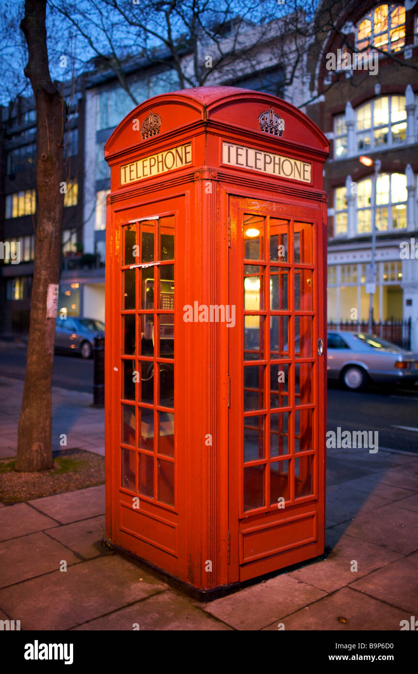 Traditional Red Telephone box, London - Stock Image