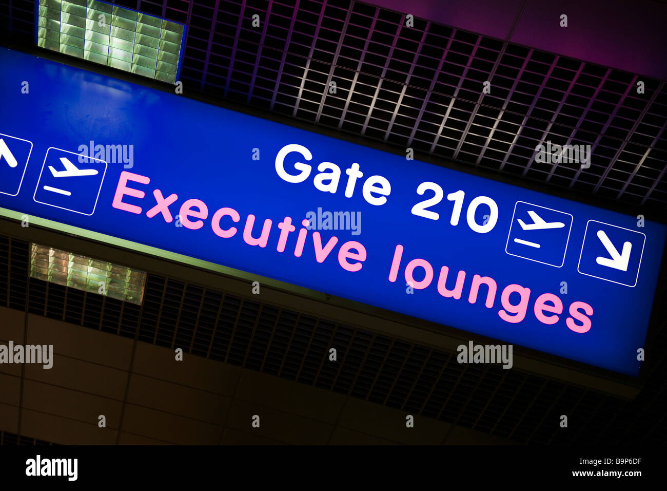 Manchester Airport UK passenger information sign for Executive Lounges - Stock Image