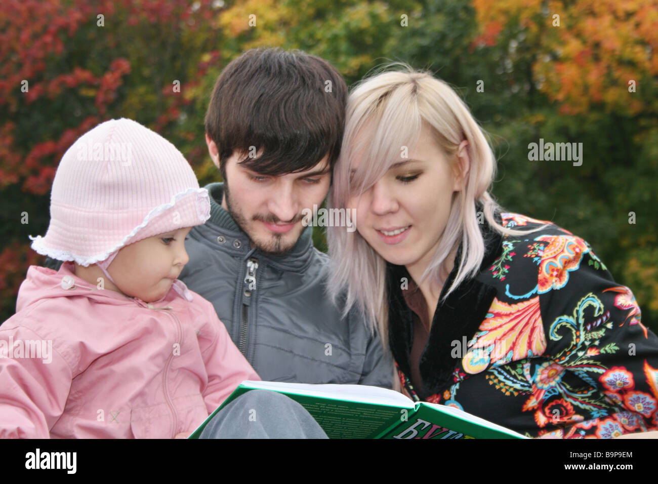 autumn family with baby read book stock photo 23232684 alamy
