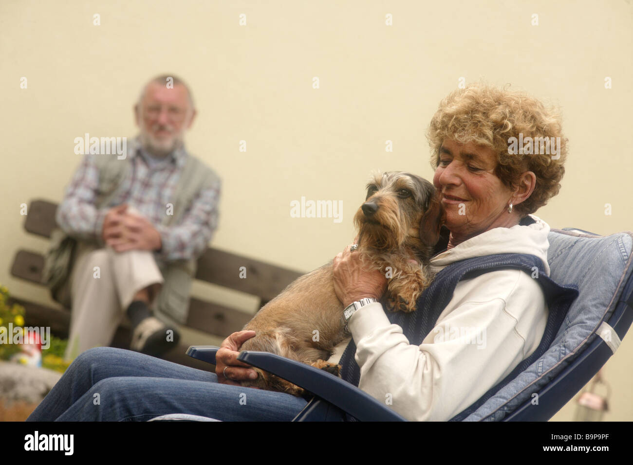 Seniors and Dog Stock Photo