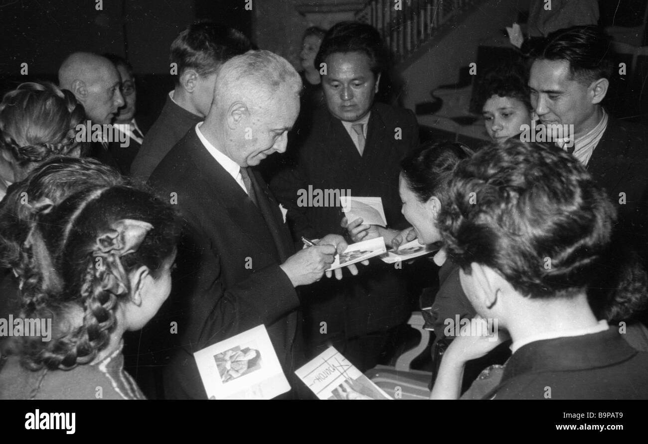 French writer Louis Aragon left giving autographs to his Moscow readers - Stock Image