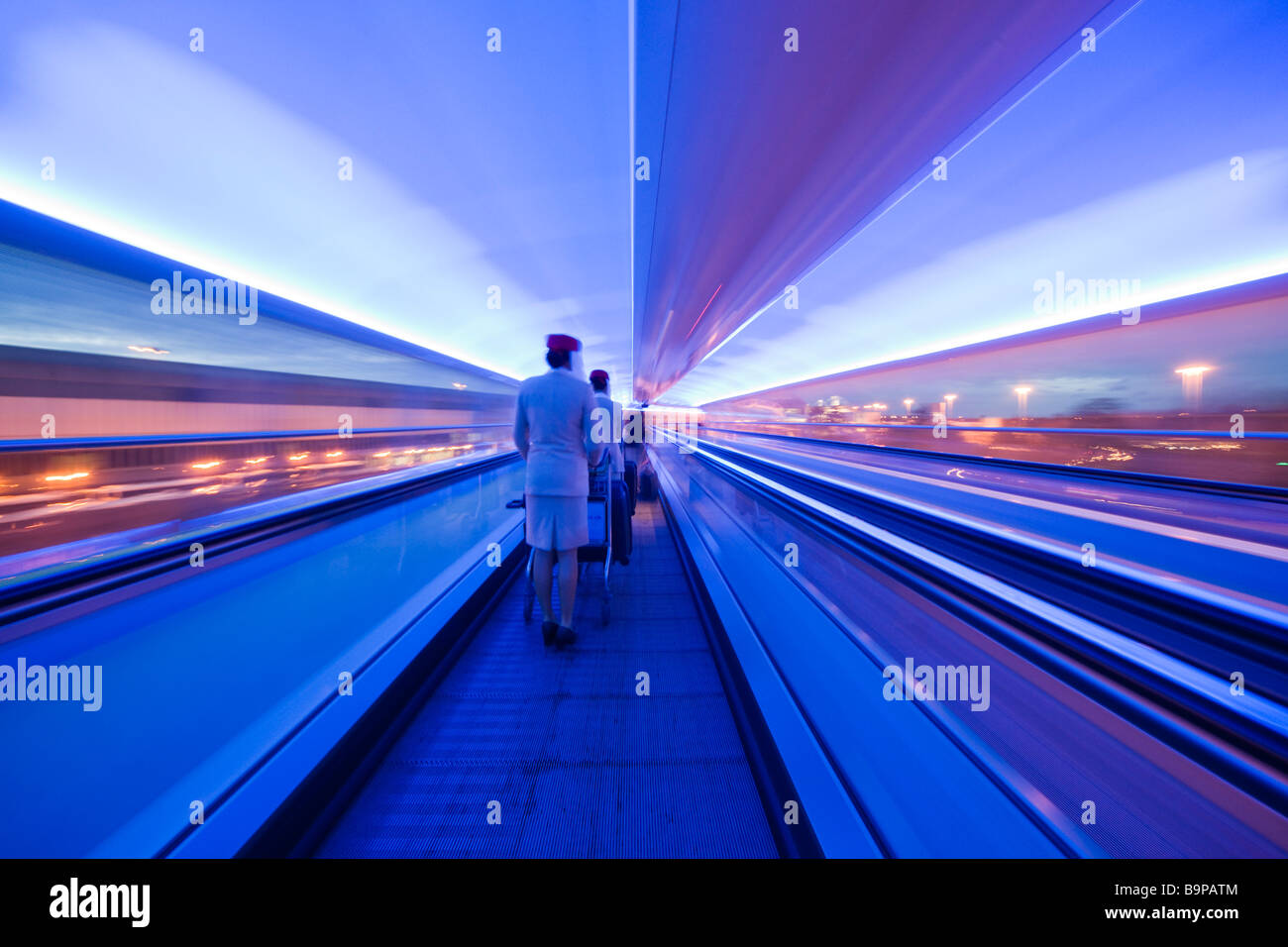 Manchester Airport UK the passenger connection walkways with travelators at night air hostesses - Stock Image