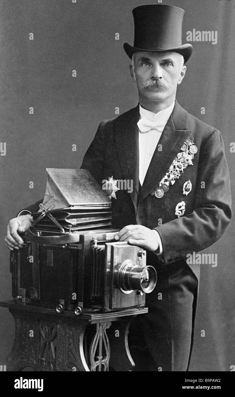 Court photographer honorary citizen and founder of photographers dynasty Karl Bulla stands near photo camera - Stock Image