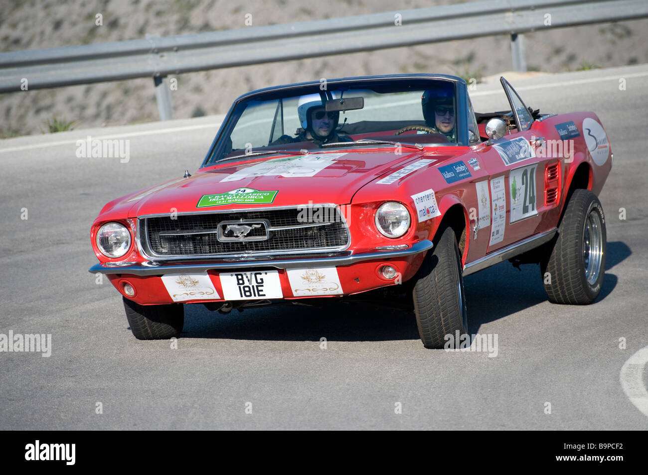 Red 1968 ford mustang car racing in the classic car rally mallorca