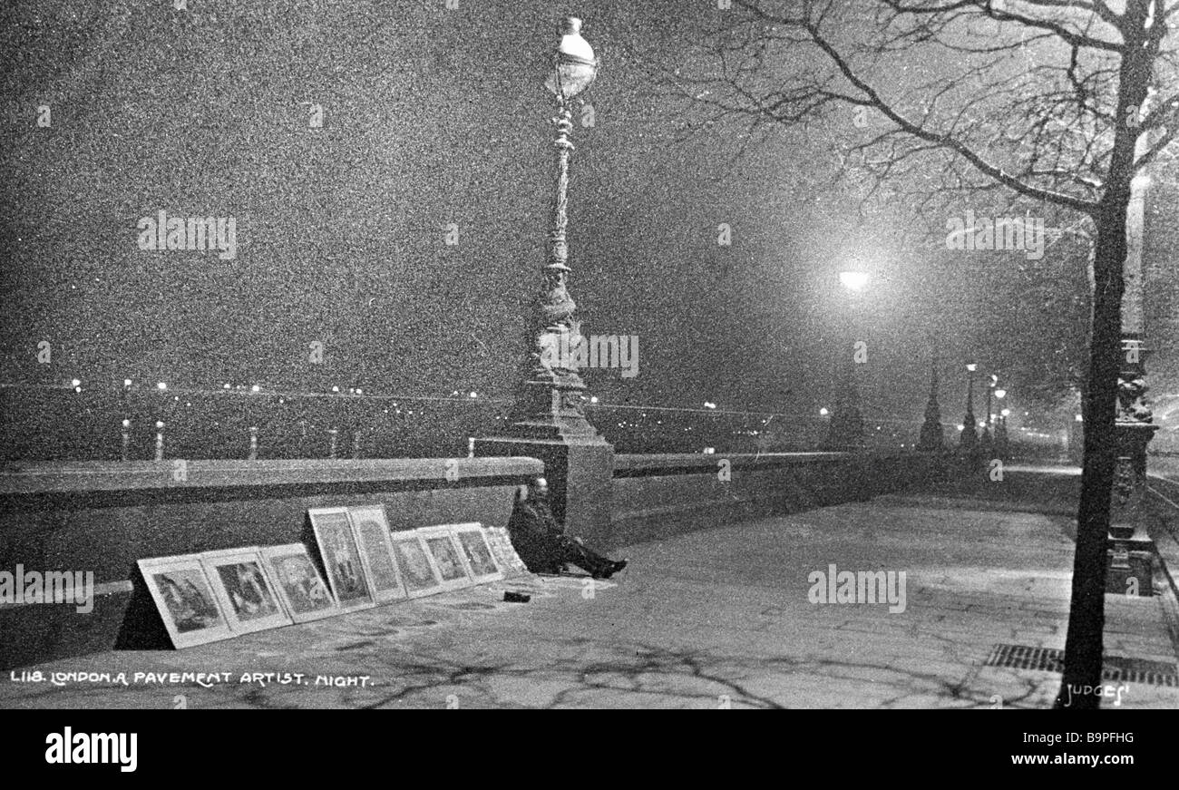 An artist selling his canvases on a London embankment - Stock Image