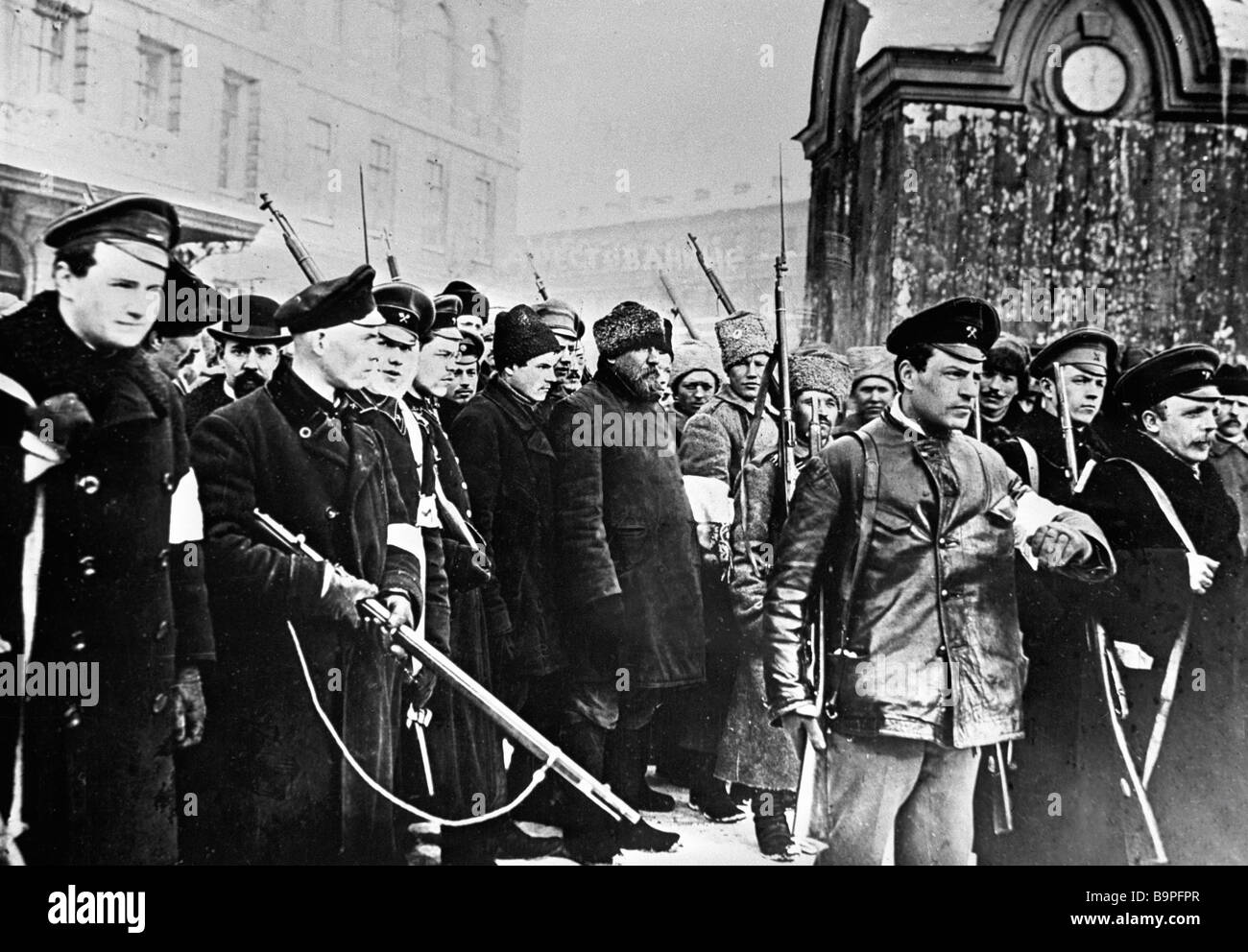 Armed insurgents convoying disguised policemen to the Taurida Palace during the February bourgeois democratic revolution Stock Photo