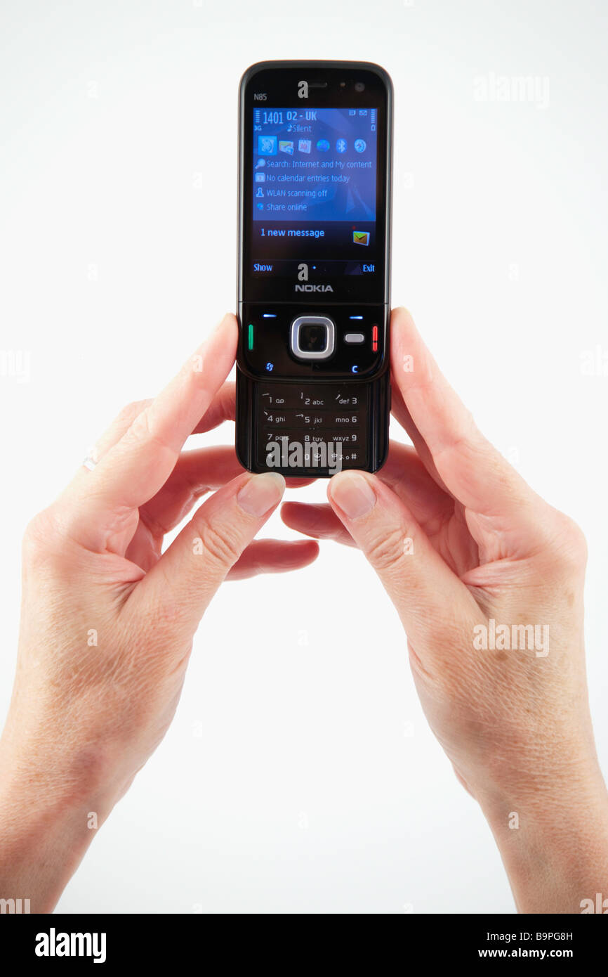 Hands Nokia Mobile Phone Communications High Resolution Stock Photography And Images Alamy
