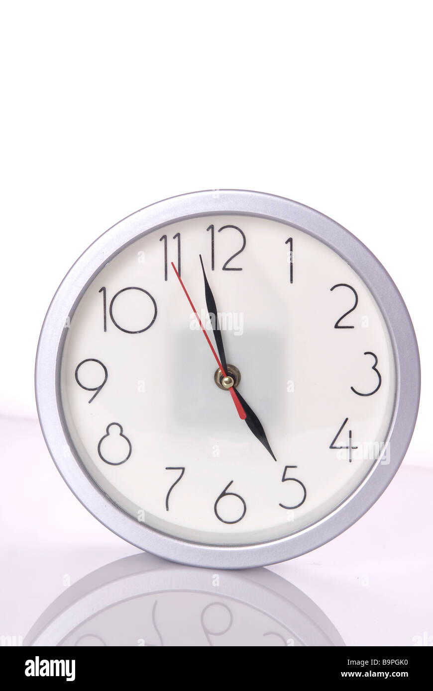 Wall clock against a white background - Stock Image
