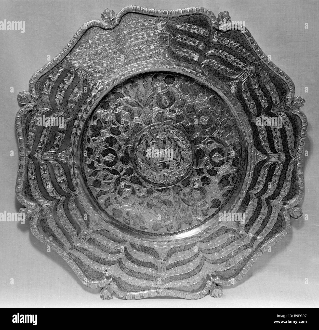 A gold plate of Boyar B M Khitrovo 1667 80s from the collection of the Moscow Kremlin s State Armory - Stock Image