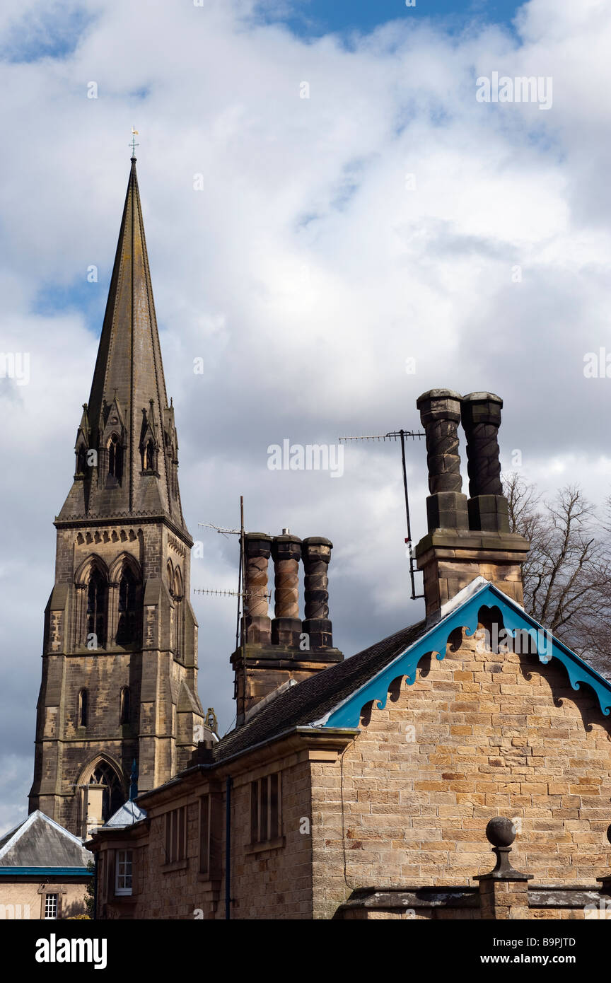 'St Peter's' church and ornate long chimney pots Edensor,Derbyshire, England, 'Great Britain' - Stock Image