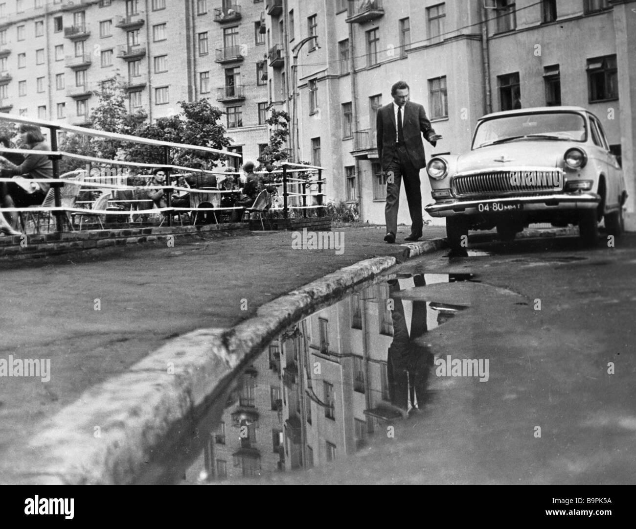 People s Artist of the U S S R Oleg Yefremov as Taxi Driver in film Three Poplars at Plyushchikha Street by Tatiana - Stock Image